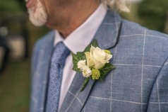Simple white rose, feverfew and scabiosa bud