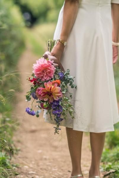 Arm sheaf bouquet of bright seasonal flowers